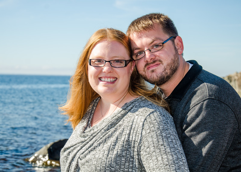Engagement photo of couple in front of lake superior