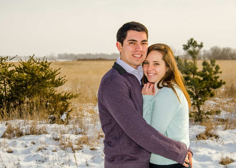 engagement photo of couple in prarie snow