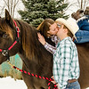 engagement photo of couple on horseback kissing