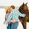 Engagement photo of couple kissing in front of horse
