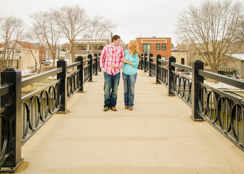 Engagement photo of couple on cement bridge