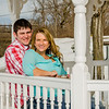 Engagement photo of couple sitting in a gazebo