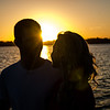Engagement photo of couples with sunset behind them