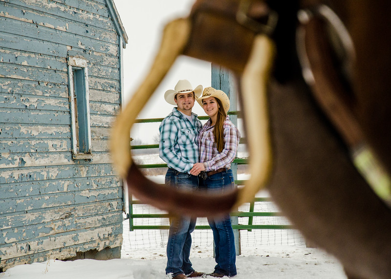 Engagement photo of couple shot through stirrups