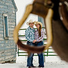 Engagement photo of couple shot through stirrups