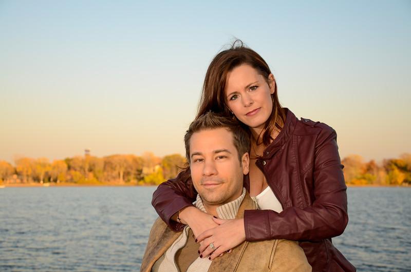 Engagement photo of couple on lake