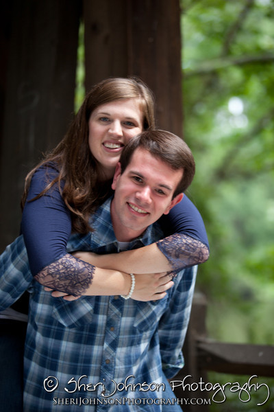 Amanda and Steven engagement photo at Stone Mountain Park at the Covered Bridge