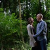 engagement couple in lush green woodland
