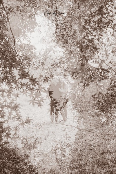 sepia engaged couple