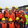 4/18/14 UB students interested in bridge engineering took a boat tour of the Tappan Zee Bridge (in the background). They saw pile driving for the foundation of the New New York Bridge. left to right:<br /> Front row: <br /> Suk-Hee Hyun<br /> Sathvika Meenakshisundaram<br /> Victor Odili<br /> <br /> Back row: <br /> Sharath<br /> Jerome O'Connor <br /> Chao Huang<br /> Nashwan al Shuwaili<br /> Gustavo De Andrade<br /> Logan Bessel<br /> Youngtae Han
