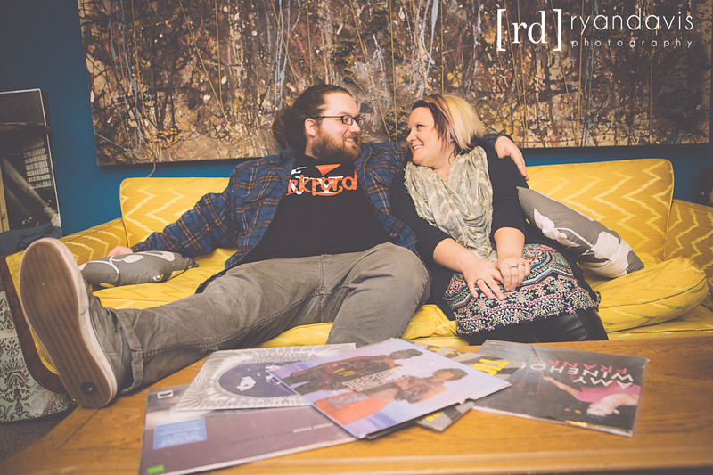 Skylar and Lauren, owners of CUlture Shock Clothing and Records in Rockford, IL share a squeeze amongst thier albums. Photographer - Ryan Davis Photography, Rockford, IL.