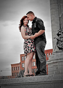 Engagement Photos at Clinton Square of Syracuse NY. Engagement and Wedding Photographer Mariana Roberts serving Syracuse NY, Liverpool NY, Baldwinsville NY, Cicero NY, Oswego NY, Fulton NY, Mexico NY, Rochester NY, Buffalo NY, and Central New York. Outdoor Engagement Photography in Upstate NY. www.MarianaRobertsPhotography.com, www.MarianaRobertsWeddings.com  Please contact Mariana Roberts to Book your event at (315) 409-6893