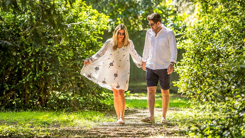 engaged couple walking hand in hand