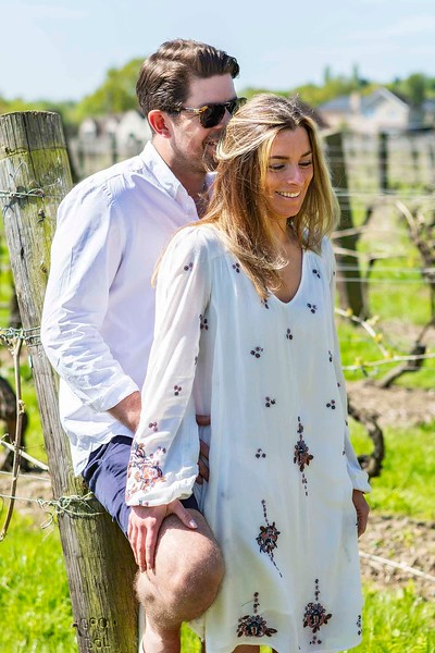 engaged couple embracing in a vineyard