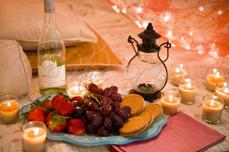 0015    A bottle of Moscato, a platter of cookies, strawberries and grapes, red gingham napkins from Pier1, lantern from Pier1, and lots of candles.