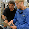 engineering-lab-coordinator-jack-esparza-helps-a-student-determine-the-dimensions-of-a-structural-piece-for-his-project_14657853579_o