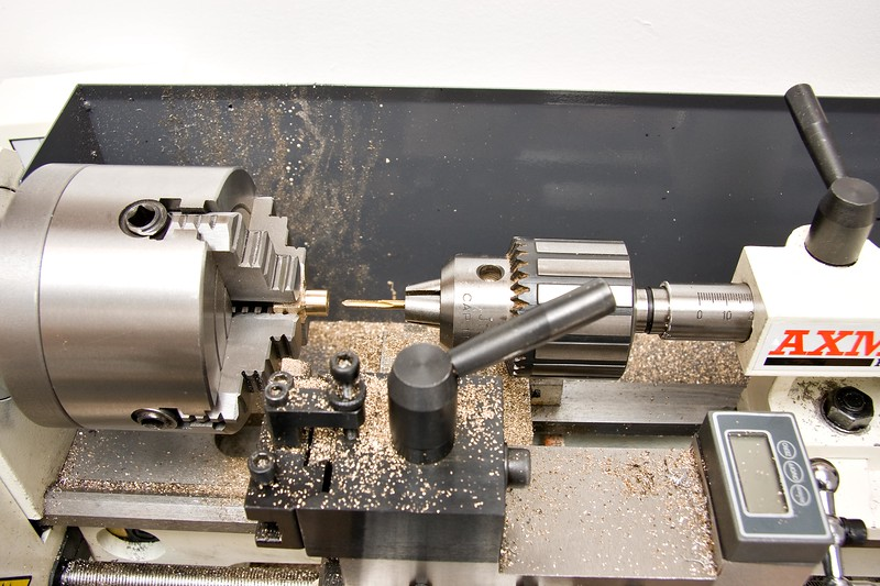 I find this to be a good method of tapping on the lathe, to explain; The drill chuck is not jammed in the MT of the tailstock, it has some grip but is free to turn with light pressure. Also the tailstock is also free to move on the ways, and the tap in the chuck is also loose enough to turn if the tap jams in the work. I then run the lathe at a very low speed.