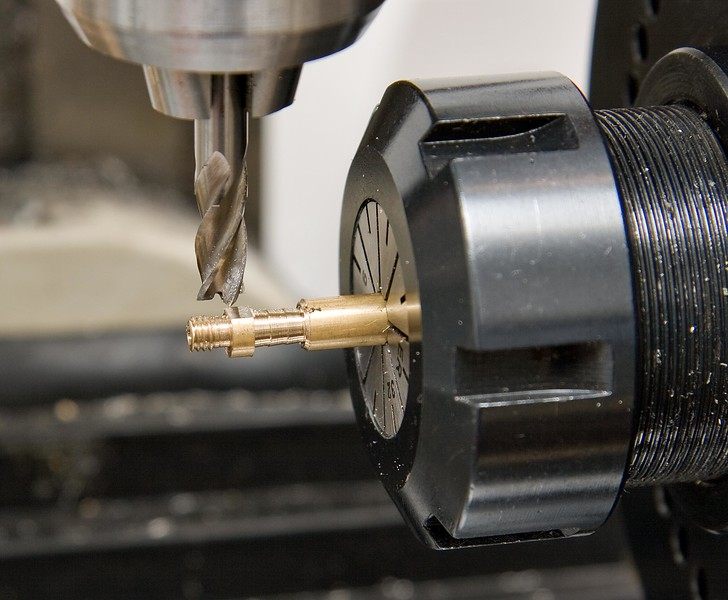 Milling a hex section on the hose barb for tightening it to the frame