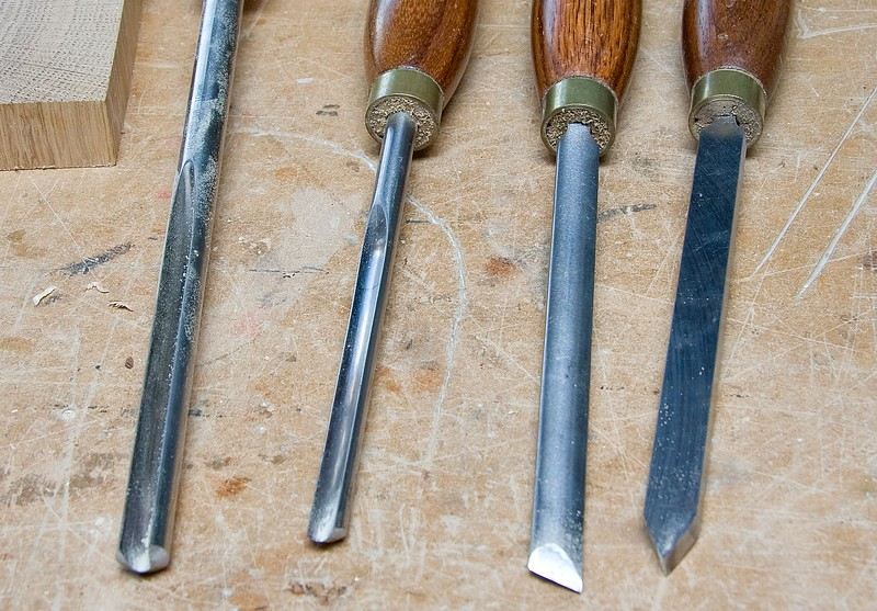 "Woodturning tools used, from left to right:- Bowl gouge, spindle gouge, skew chisel, 1/4"" parting tool."