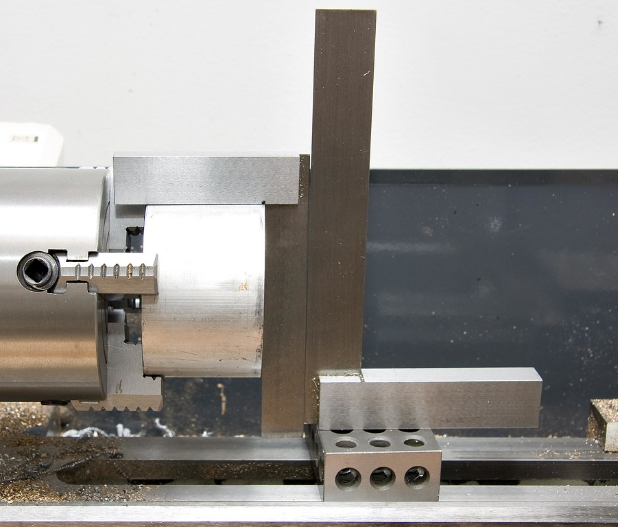 "Method of making sure the rough-cut 3"" blank is gripped paralell to the lathe ways, in order to face each rough-cut end smooth and true."