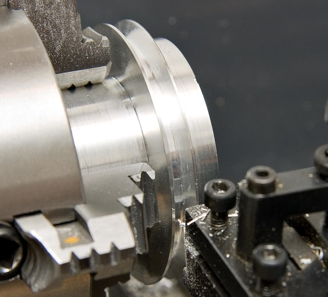 Plunge cutting the V shape with a custom ground Hss tool