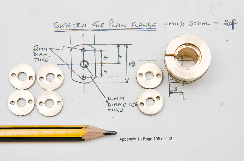 The flanges, complete apart from having the sides milled flat, along with the split collet