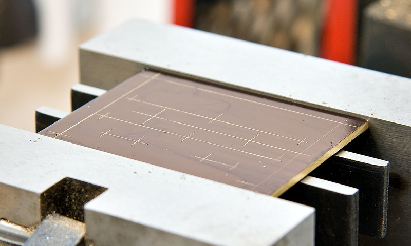 Top mounting plate marked up for drilling
