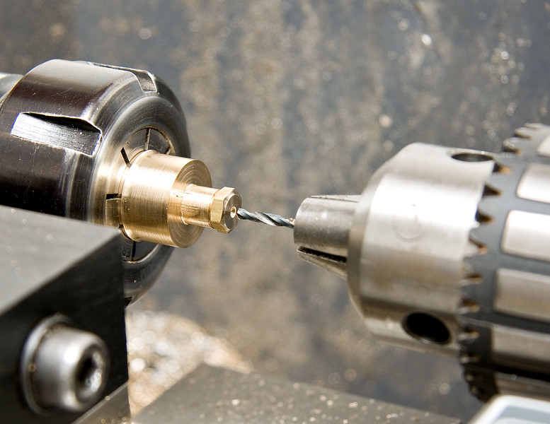 Drilling both packing gland and screw at the same time to keep concentricity