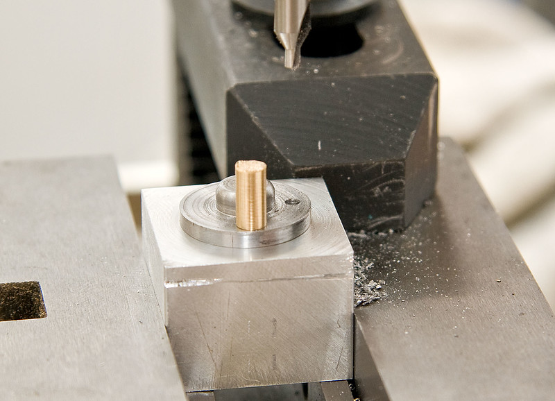 Jig for drilling top-caps and packing glands