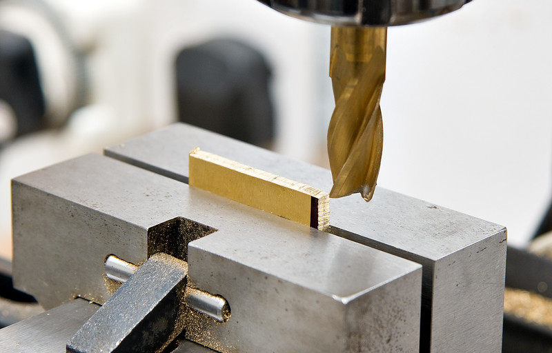 milling a piece of 4mm thick brass down to the right size for the eccentric blocks