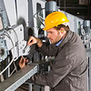 A male maintenance engineer at work on an industrial appliance