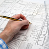Engineer working on a project with pencil and ruler
