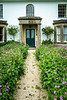The Lodge with a pathway of flowers in the village of Avebury, Wiltshire, England.