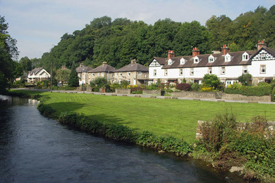 Crossing the bridge, the large Lumford cottages are visible, next to Riverwalk and several other bed and breakfasts.