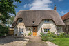 A thatch roofed home near Castle Combe, Wiltshire, England, Europe.