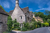 A street of stone buildings and homes in the picturesque village of Castle Combe, Wiltshire, England, Europe.