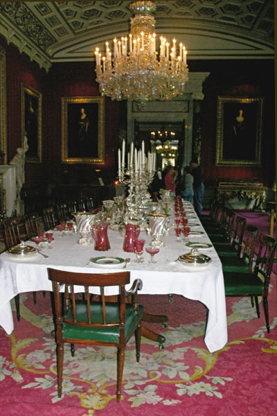 A long view of the dining table and chandelier  in the Great Dining Room