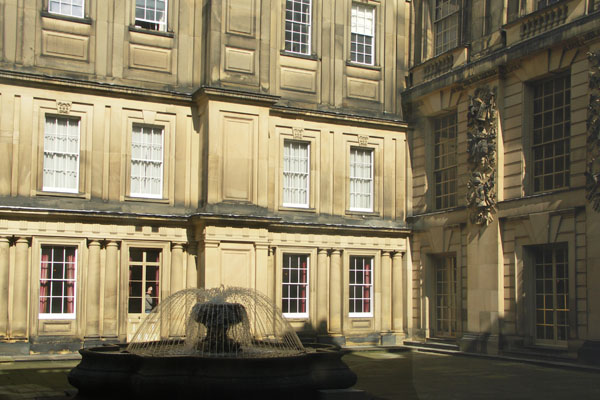 View of the courtyard and fountain from a window inside Chatsworth
