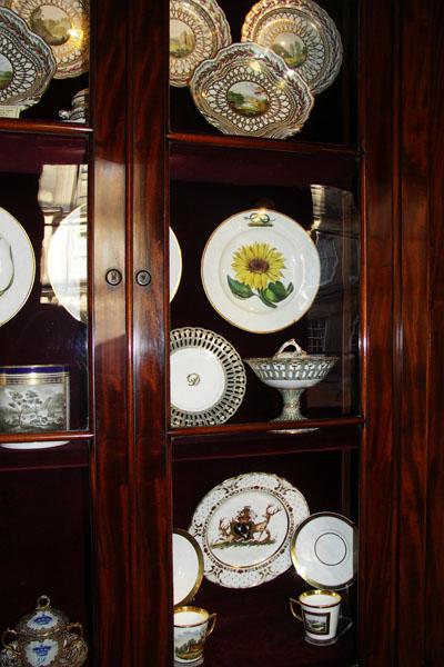 18th century dinnerware in the North entrance corridor