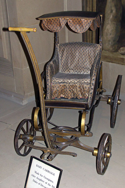 Late 18th century baby carriage, in an alcove under the Great Stairs