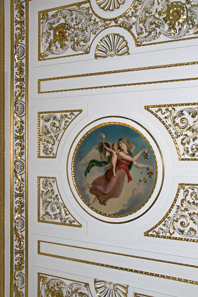 A view of the gilded stucco ceiling with paintings by Verrio in the Library.