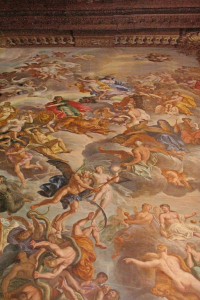 Ceiling painting at Chatsworth. I intend to identify it soon! It may be the from Triumph of Caesar ceiling in the Painted Hall, but most of the capes in that painting are a deep red.