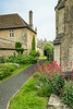 A village lane with flowers in Corsham, Wiltshire, England.