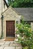 An entrance door and flowers at the Bath Lodge Castle near Bath, England, Europe.