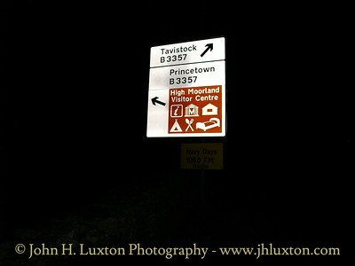 Road sign at night.