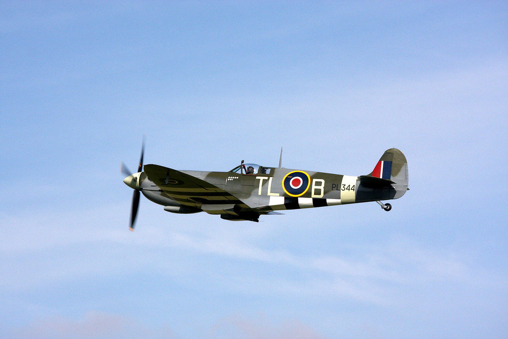 Spitfire at Goodwood Revival flying from the old WWII airfield. Goodwood Revival is held where WWII RAF Westhampnett was located in England's South Coast county of Sussex near Chicester.