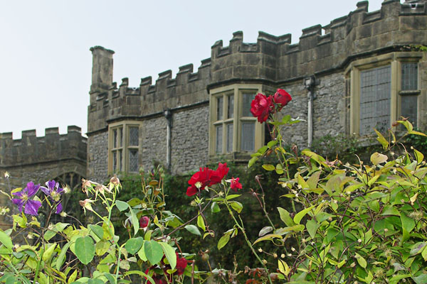 Haddon Hall, view from garden, the far end of the Hall,with more flowers in the foreground.