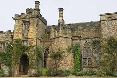 Haddon Hall, view from courtyard. If the building looks uneven, that's because it is! The buildings were bent slightly to connect the various parts. The courtyard view of one of the entrances is really quite beautiful.