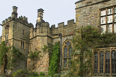 Haddon Hall, view from courtyard. From the courtyard, you can see the 15th cenutry octagonal belltower, decorative gargoyles near the various entrances, and exterior stairs leading to the earl's apartments.