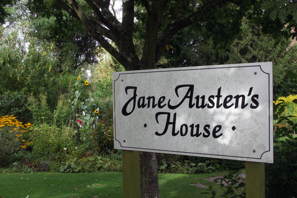 Sign in front of Jane Austen's house (Chawton cottage) which is now the Chawton Jane Austen museum, 15 miles from Steventon. When Edward Knight's adopted parents died, he was heir to the Chawton estate, and provided a cottage on the estate to Jane, Cassandra and their mother.